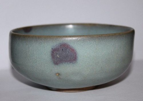 A Jun ware shallow bowl.