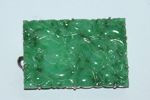 An apple green jadeite brooch.