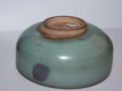 A Jun ware shallow bowl.