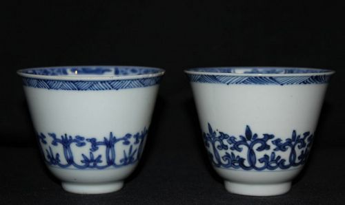 A pair of blue and white wine cups.