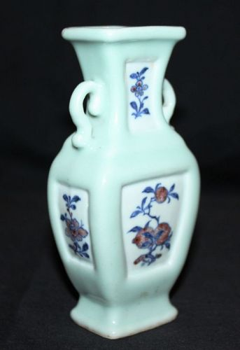 A Chinese celadon small baluster vase.