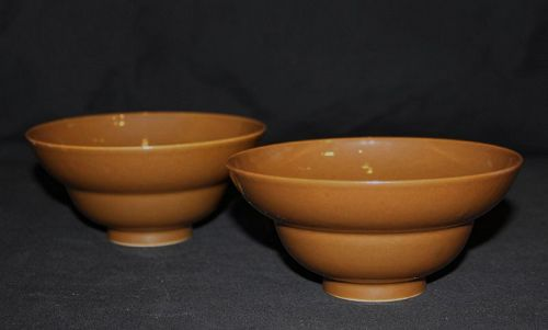 A pair of Qianlong brown glazed double ogee bowls.