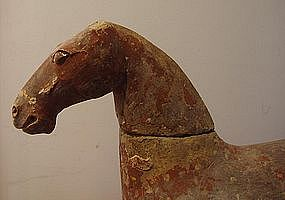 A Chinese pottery Han Dynasty figure of a horse.