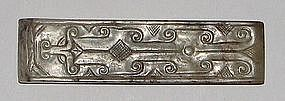 A Chinese jade scabbard fitting from a belt.