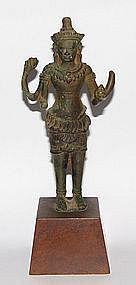 A 12th century Khymer bronze figure of Avalokitisvara.
