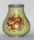 A Chinese �hu� shaped vase decorated with red dragons.