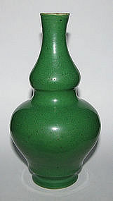 A Chinese crackled green vase.