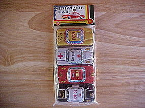 MADE IN JAPAN SET OF 4 TIN LITHO CARS POLICE/FIRE/TAXI
