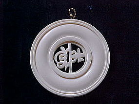 CARVED IVORY CIRCULAR PENDANT