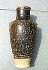 A Chinese mottled brown glazed stoneware baluster vase.