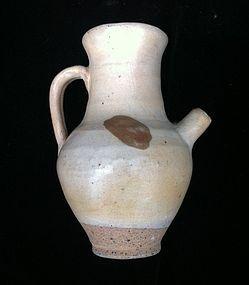 Chinese Tang cream glaze stoneware ewer