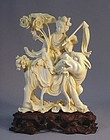 CHINESE IVORY CARVING OF A FAIRY AND MYTHICAL BEAST