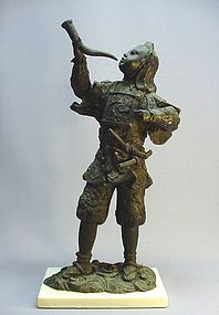 JAPANESE CAST METAL FIGURE OF A YOUNG SOLDIER