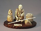 JAPANESE IVORY OKIMONO OF A MERCHANT