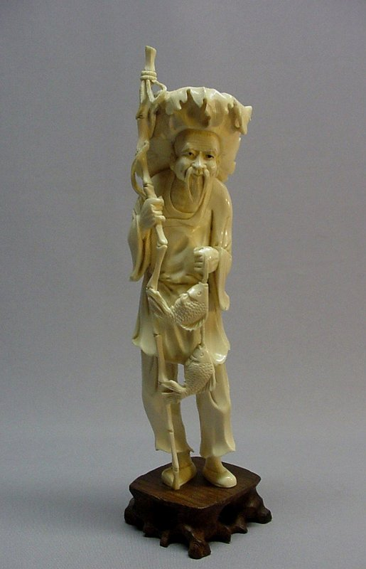 CHINESE IVORY CARVING OF A FISHERMAN