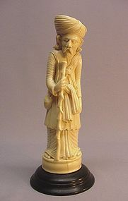 ASIAN IVORY CARVING OF A TRAVELING MERCHANT