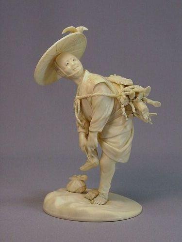 Japanese ivory okimono of a wood cutter