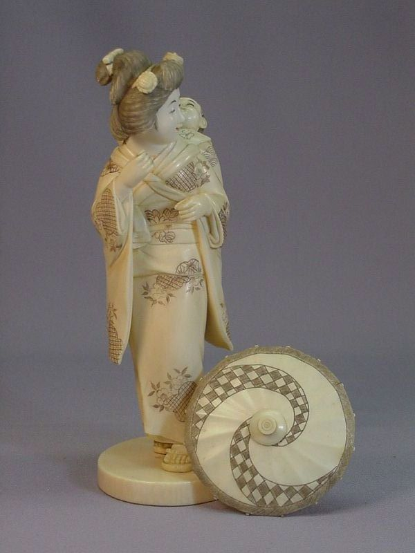 Japanese ivory carving of mother and child