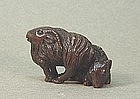 JAPANESE CARVED WOOD NETSUKE OF TWO RAMS
