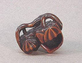JAPANESE CARVED WOOD NETSUKE OF A PLANT (LANTERN)