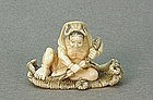 JAPANESE CARVED IVORY NETSUKE OF A DEMON