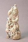 JAPANESE 19TH CENTURY CARVED IVORY OKIMONO OF A HUNTER