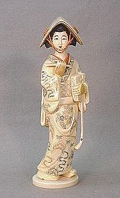 JAPANESE 20TH CENTURY CARVED IVORY OKIMONO OF A GEISHA