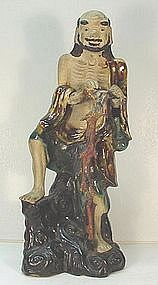 CHINESE POTTERY FIGURE OF AN IMMORTAL