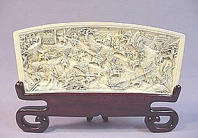 CHINESE CARVED IVORY PANEL OF A BATTLE SCENE