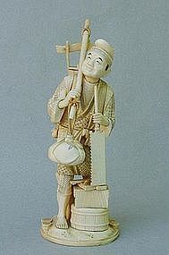 JAPANESE IVORY CARVING OF A CARPENTER