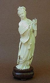 CHINESE CARVED IVORY BEAUTY HOLDING A FAN