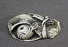 JAPANESE IVORY NETSUKE OF FISH WRAPPED IN BAMBOO LEAF