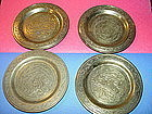 Four Middle Eastern Brass Coasters