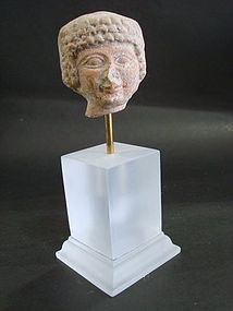 A HOLY LAND TERRACOTTA HEAD OF THE GODDESS ASTARTE