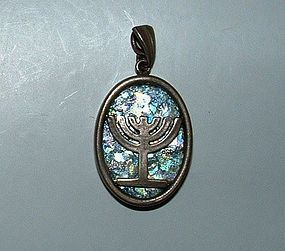 A ROMAN GLASS FRAGMENT SET IN MODERN SILVER PENDANT WITH MENORAH