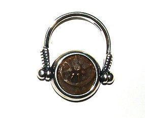 A WIDOWS MITE BRONZE PRUTAH SET IN MODERN SILVER RING