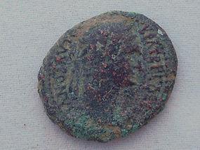 A ROMAN PROVINCIAL BRONZE COIN OF TRAJAN