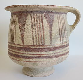 A CANAANITE TERRACOTTA BICONICAL JUG