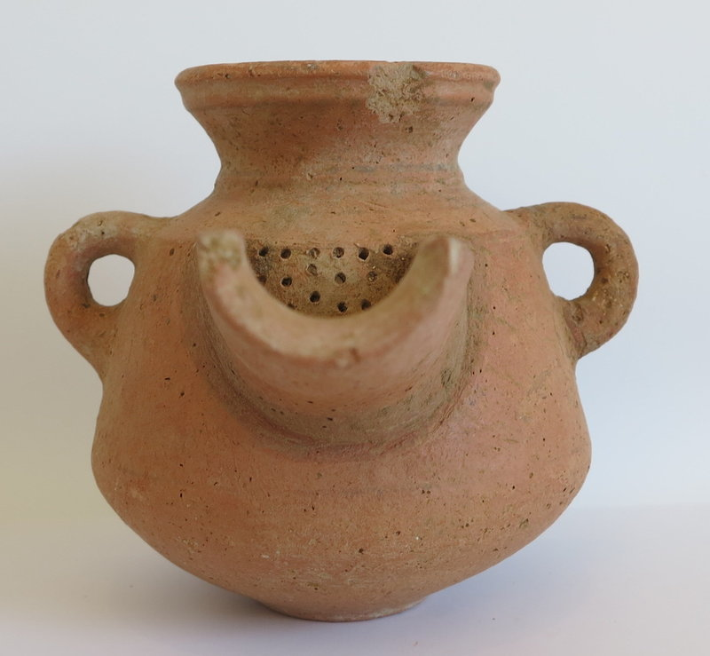 AN EXTERMELY RARE IRON AGE TERRACOTTA WINE STRAINER
