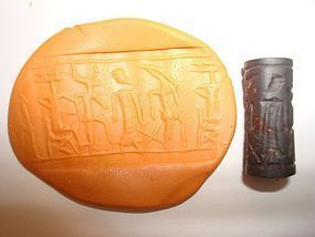 A PHILISTINE BLACK SERPENTINE CYLINDER SEAL