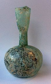 A HERODIAN GLASS BOTTLE