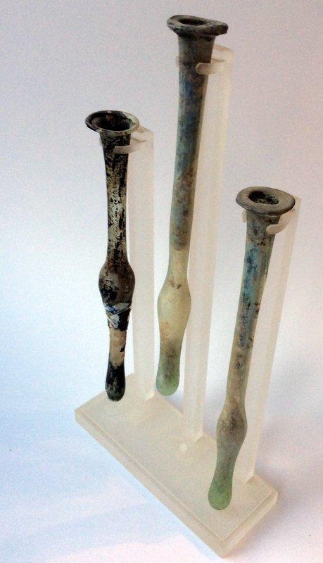 A SET OF THREE RARE EARLY ROMAN GLASS TUBES