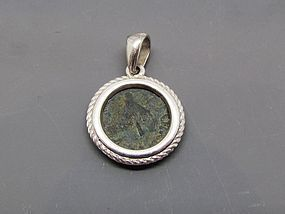 A BRONZE PRUTAH ISSUED UNDER HEROD AGRIPPA I SET IN SILVER PENDANT