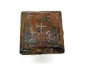 A BYZANTINE BRONZE COMMERCIAL WEIGHT WITH SILVER INLAY