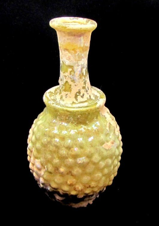 A ROMAN GREEEN GLASS GRAPE FLASK