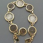 THREE CRUSADER COINS AND FOUR WIDOWS  MITES SET IN A 18K GOLD BRACELET