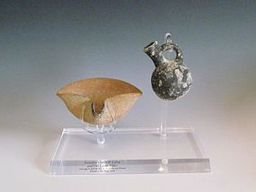 AN ISRAELITE TERRACOTTA JUGLET AND OIL LAMP SET