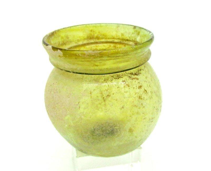 A ROMAN GREEN GLASS JAR