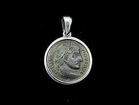 A BRONZE FOLLIS OF CONSTANTINE THE GREAT SET IN SILVER PENDANT