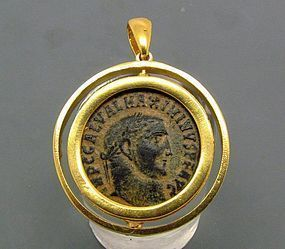 A ROMAN BRONZE FOLLIS OF MAXIMINUS II IN 22K GOLD FILLED PENDANT